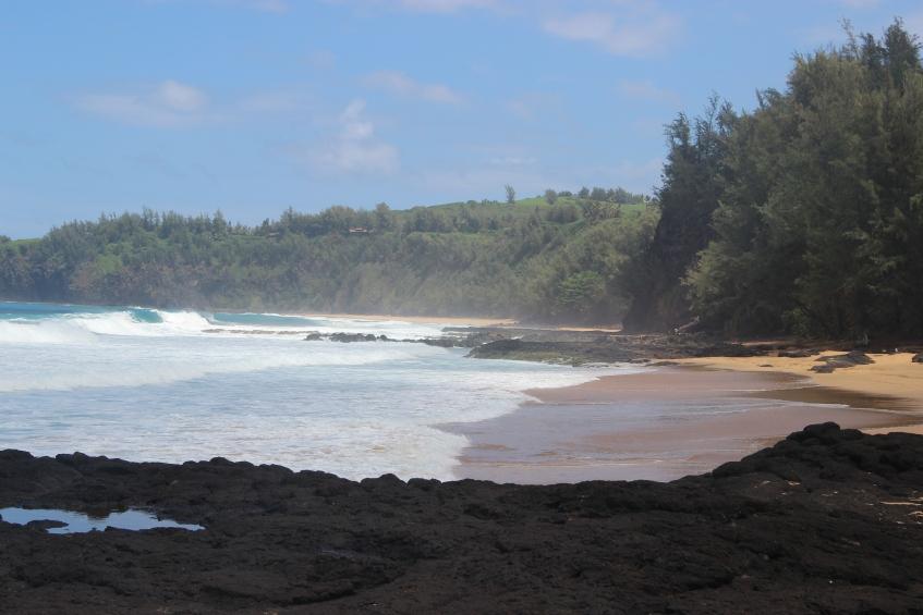 Surf, sand, and rocks - beautiful.