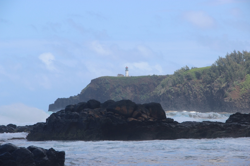 Lighthouse on the cliffs above.